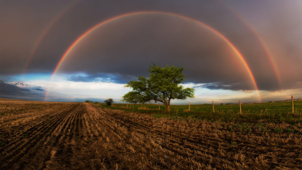 A nature photograph of a double rainbow in Saskatchewan