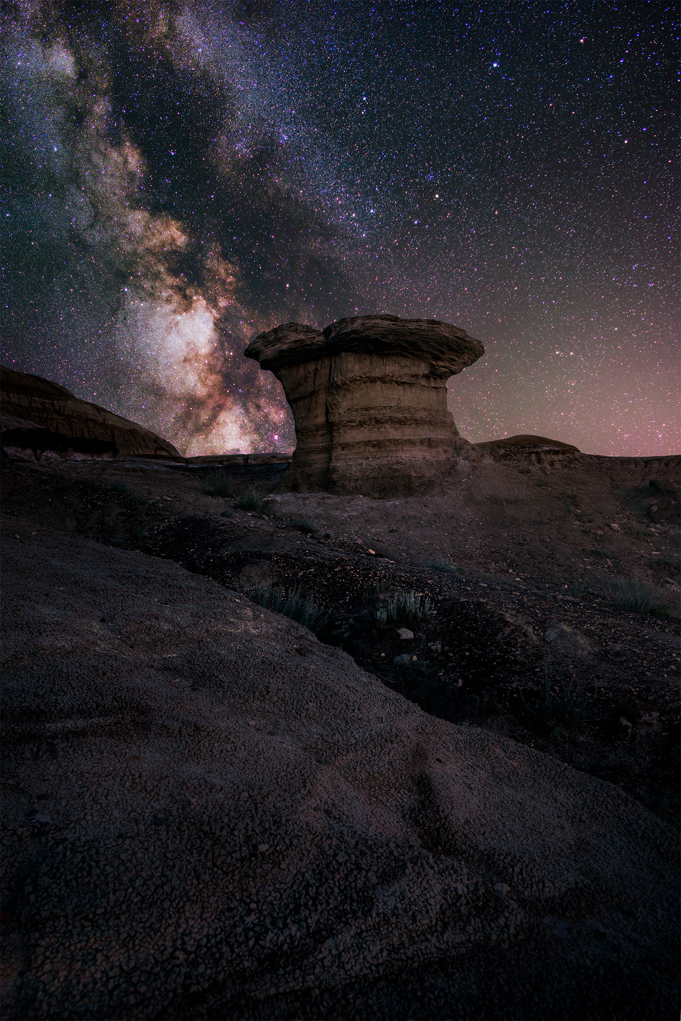 A hoodoo in Avonlea, Saskatchewan with the milky way over it