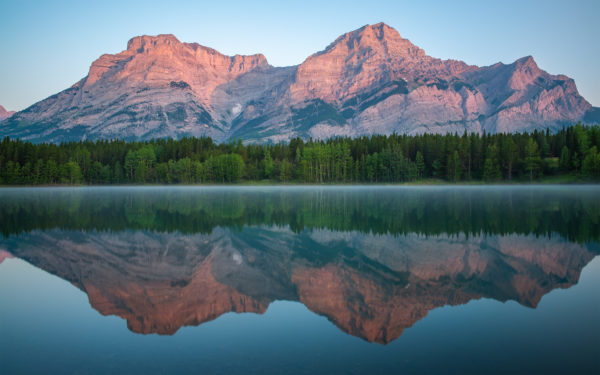 A landscape photograph of sunrise Wedge Pond Alberta.