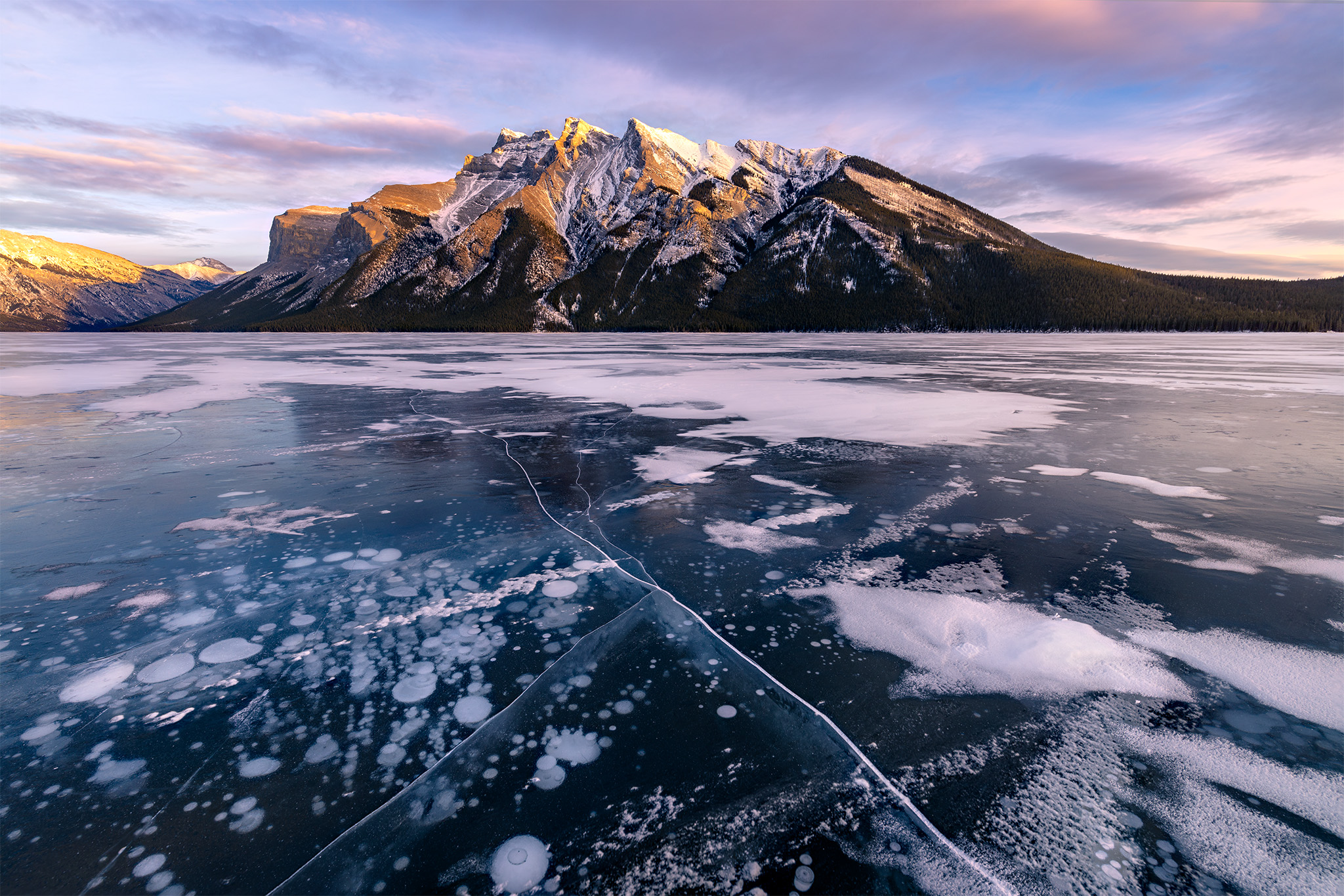 Landscape Photography of frozen bubbles at Lake Minnewanka in the Canadian Rockies