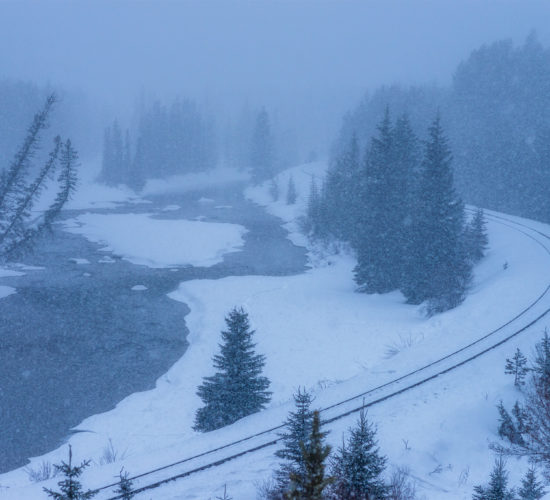 Landscape Photography in a snowstorm at Morant's Curve in the Canadian Rockies, Alberta.