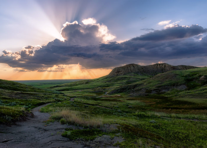 Landscape Photography of a sun burst in Grasslands National Park, Saskatchewan
