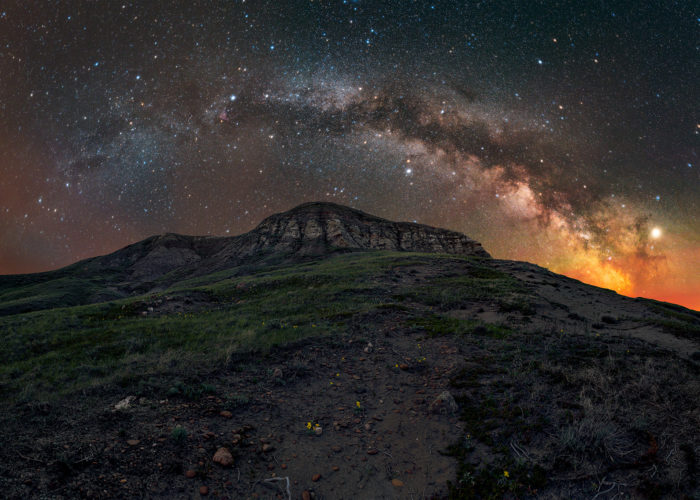 Landscape astrophotography of the summer milky way in a 180 degree panorama of Eagle Butte in Grasslands National Park during a night photography workshop