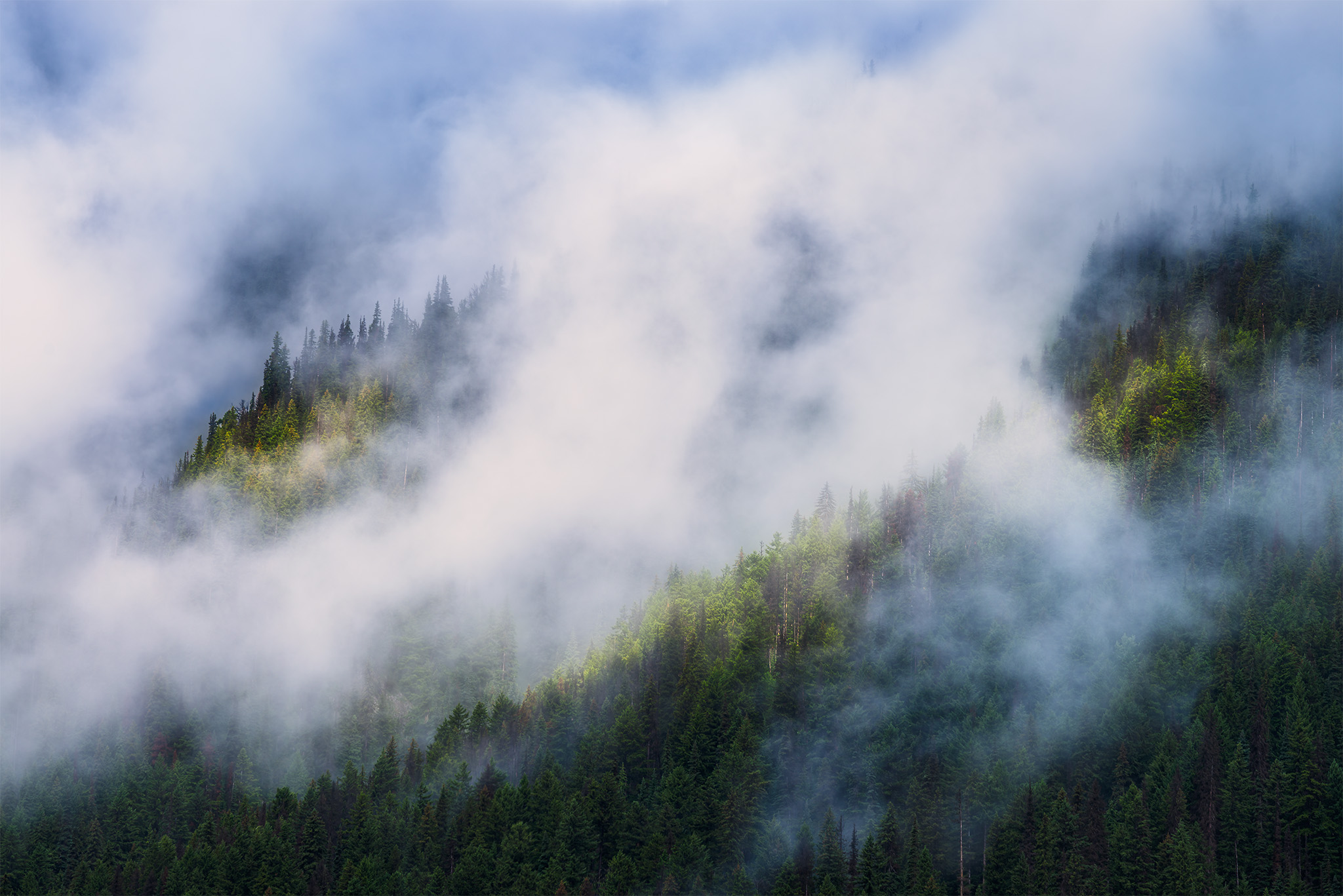 Intimate landscape photography of light hitting the side of a mountain in British Columbia
