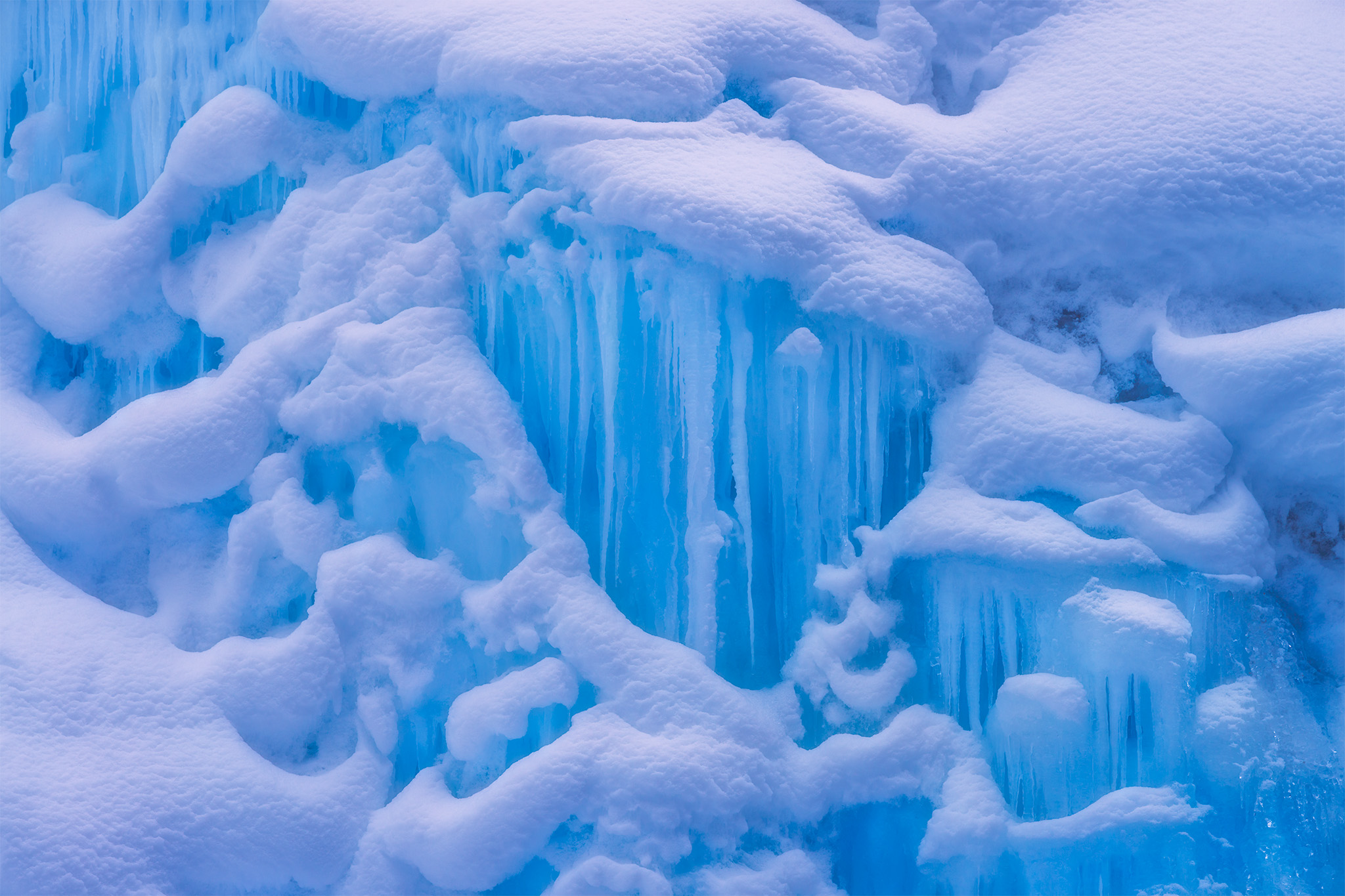 An intimate landscape photograph of the ice at Johnston Canyon in Banff National Park