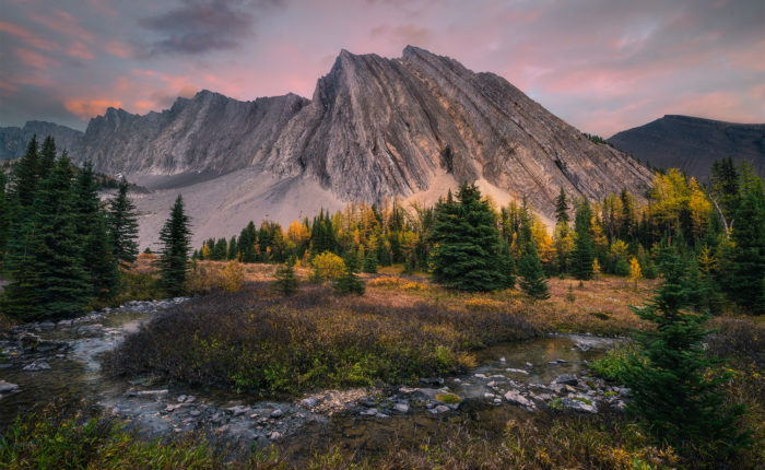 A landscape photograph captured at Chester Lake in the Canadian Rockies at sunset