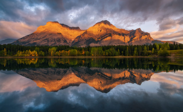 A landscape photograph taken during sunrise at Wedge Pond in the Canadian Rockies