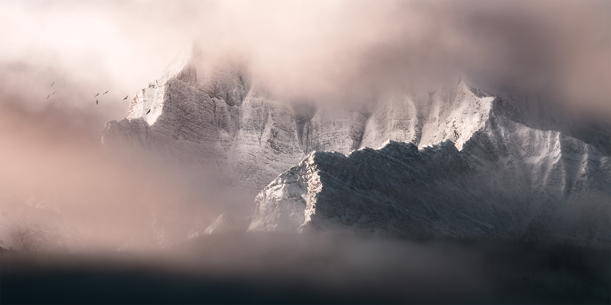 A landscape photograph of Castle Mountain in the Canadian Rockies under morning light