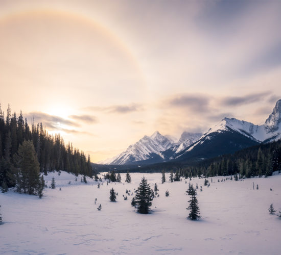 Landscape photography of a sun halo in the Canadian Rockies during winter